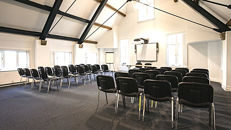 Conference Space Two **Manchester Cathedral Visitor Centre is home to two spacious, multi-functional conference rooms for hire.**  Located in the city centre right in the heart of Manchester's medieval quarter, our stylish & flexible meeting rooms here at Manchester Cathedral Visitor Centre offer multi-purpose event space ideal for business meetings, small conferences and training seminars.  Displaying a contemporary, light and airy feel of the venue with stunning views of the iconic Cathedral and its gardens; Meeting Rooms at MCVC is the perfect setting for your next event.  With day delegate packages from £25, fully equipped conference rooms  and lunch provided by Harvey Nichols, we're proud to work with organisations throughout the city to deliver them successful and memorable events.