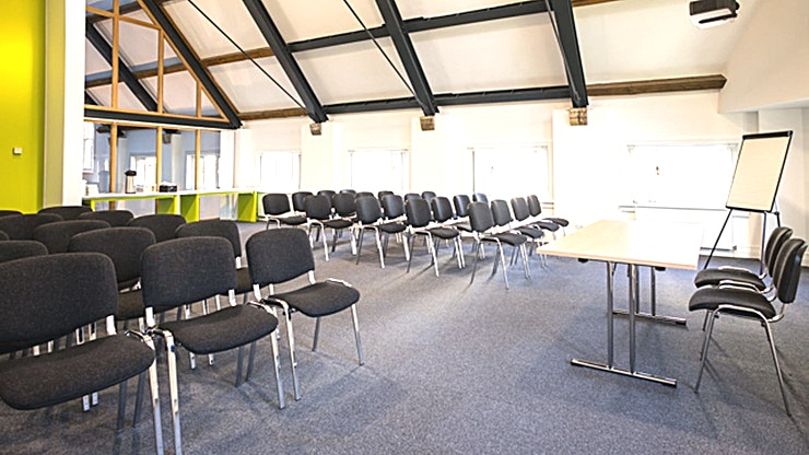 Conference Space One **Located in the city centre right in the heart of Manchester's medieval quarter, our stylish & flexible meeting rooms here at Manchester Cathedral Visitor Centre offer multi-purpose event space ideal for business meetings, small conferences and training seminars.**  Displaying a contemporary, light and airy feel of the venue with stunning views of the iconic Cathedral and its gardens; Meeting Rooms at MCVC is the perfect setting for your next event.  With day delegate packages from £25, fully equipped conference rooms  and lunch provided by Harvey Nichols, we're proud to work with organisations throughout the city to deliver them successful and memorable events.
