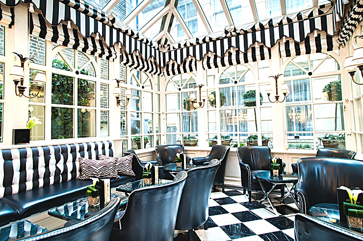The Conservatory **Hire The Conservatory at The Milestone Hotel for one of the best options for party venue hire London has to offer!**   The Milestone Hotel, located in the heart of London, has some amazing Spaces