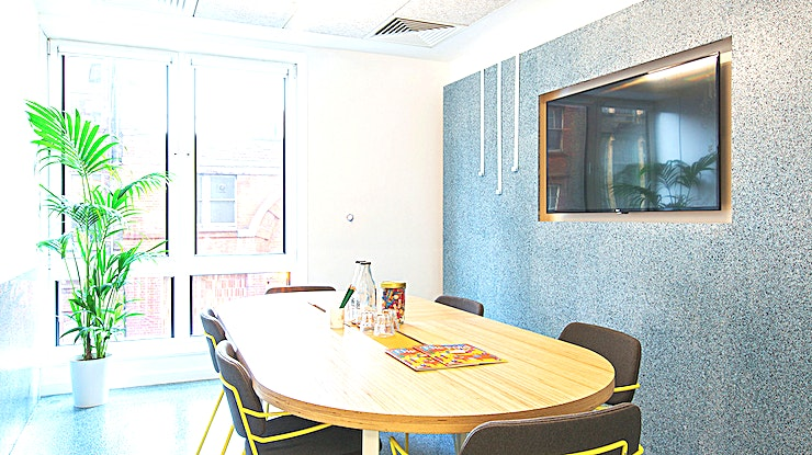 Meeting Room 5 **Meeting Room 5 at The Office Group at 2 Angel Square is one of the best options for meeting room hire London has to offer.**  The Office Group are home to some of the best meeting rooms to hire across London. Their Angel Sqaure centre in Islington is inspired by the Memphis design style and is fun atmosphere to host your next meeting room hire. The building offers a range of office spaces in the heart of London, including individual offices, large co-working and drop-in spaces and a range of meeting rooms, conference rooms and event spaces. On the outside, the entrance is on Upper St with probably the broadest selection of restaurants and eateries that you'll find in London. And of course the tube couldn't be closer!  Meeting Room 5 at The Office Group's Angel Square centre can accomodate up to 6 delegates for a boardroom style meeting. The room is flooded with natural light and comes fully equipped with a state of the art projector and screen.