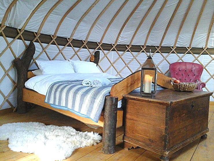 Glamping site  An eco-friendly luxury yurts site in the Surrey Hills near London, an hour from central London, so throw a few clothes into a bag, grab your toothbrush and wellies and come visit! We'll provide biodegradable toiletries, linen and basket of logs for your wood burner. 