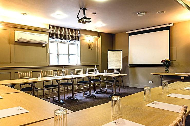 Ponds Meeting room **Hire the Ponds Meeting room at the Greyhound pub for one of the best options for venue hire London has to offer right off the beaten track.**   Steeped in local heritage in the heart of Carshalton with a view of Carshalton Ponds is The Greyhound pub. This is a friendly local pub with 19 stylish bedrooms in our Hotel Annex alongside 2 feature rooms. With three private hire spaces suitable from private dining to meetings.  The Ponds Meeting room can accomodate between 30 - 40 Guests for a wide range of different events. Whether that's a working lunch meeting or a celebatory drinks reception. This is one of the best options for private venue hire on the outskirts of London. This Space is primiarily used as a meeting room, as it is fully equipped with all the state of the art technology you might need for a productive team get together.