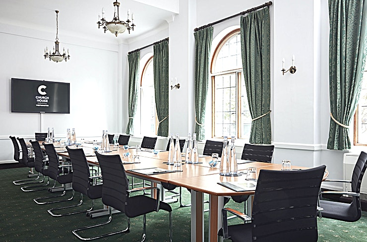 The Abbey Room **Hire The Abbey Room at the Church House in Westminster for one of the best options for venue hire London.**  Church House in Westminster is one of the capital's true hidden gems, this top London venue hire is set within Dean's Yard and offers a peaceful and green setting along with stunning views of Westminster Abbey whilst being only a few minutes' walk from Big Ben, The Houses of Parliament and St James's Park.  Located on the ground floor, our Abbey Room overlooks Dean's Yard and Westminster Abbey. This versatile meeting room is adjacent to the Westminster and Herbert Baker Rooms and is well-suited to private corporate meetings, intimate dinners, atmospheric receptions and interview sessions. The Abbey room is suitable for hire for events such as conferences and meetings and is also ideal as a training venue/room.