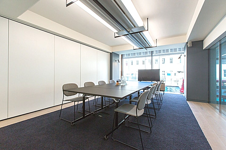 Meeting Room 1  **Meeting Room 1 at The Office Group's Eastbourne Terrace is one of the best options for meeting room hire London has to offer.**  A perfect complement to the Grade-1 listed Paddington station next door (another TOG space don't you know), our office building at number 20 Eastbourne terrace is big on style and features. The 1960s heavy concrete office block has been stripped back and refreshed to create a light and roomy space with a striking scandi-inspired 'Sky Garden' style, created in partnership with architects Stiff & Trevillion. A standout mix of flexible workspace awaits in Paddington, including one of our largest co-working spaces to date, studio offices perfect for startups, beautiful offices, extraordinary event spaces and light, comfortable meeting rooms.  And all this comes with stunning panoramic city views, café to keep you fed and watered plus access to a 2,000 sq. ft. roof garden for that extra bit of 'wow' factor. Plus, there's space for 160 bikes.