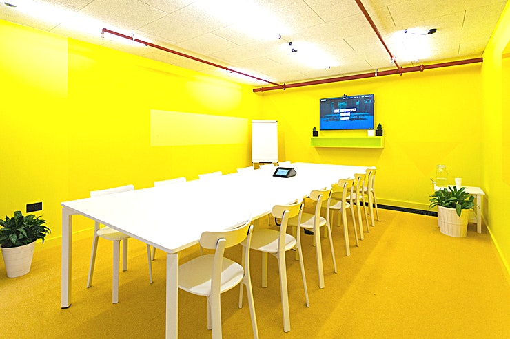"""Spaceport **Hire Spaceport at Huckletree for a top London meeting room to hire for your next productive get together!**   Yes, it may be based in our West London workspace but Spaceport's spiritual home is the out-of-this-world base for future space tourism. Ideal for up to 12 people, our largest meeting room is a vibrant space all set up for pitches, team away days and client presentations. Spaceport is equipped with a 49"""" HD screen, microphone and camera, whiteboards and the essentials: tea, coffee and water."""