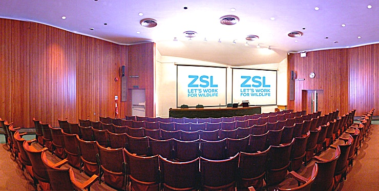 Huxley Lecture Theatre  and Bartlett Suite  **This is the Huxley Lecture Theatre  and Bartlett Suite at ZSL London Zoo -  unique London venue to hire for your next corporate event with an animal twist!**  These two adjoining function spaces are perfect for corporate meetings or educational presentations and can be booked separately or as one. Whilst the Huxley Lecture Theatre features traditional fixed tiered seating, the Bartlett Suite is more versatile and can be used either as a boardroom, extra seating for the theatre or simply a breakout area. The private foyer for the rooms boasts plenty of natural daylight and is ideal for refreshments and registration.