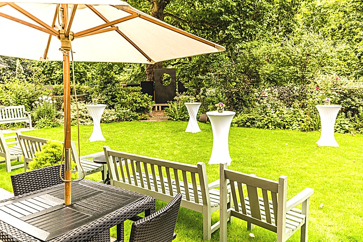 Garden at the Royal Over-Seas League **If you're looking for one of the most beautiful outdoor venues for hire London has to offer, then hire the Garden at The Royal Over-Seas League for the perfect outdoor party venue!**   With the high price of real estate in the capital, many people might think that garden party venues in London are impossible to come across. However, they would be very much mistaken, the Garden at the Royal Over-Seas League is situated in a private space overlooking Green Park. This space is available for semi-private hire during the summer season for BBQ's and receptions.    We can cater for numbers from 40 to 80 serving tempting hot and cold dishes, light bites and platters the ROSL Garden is a sanctuary from the bustle of London. Hire the Garden for the perfect garden party venue in true al fresco style.