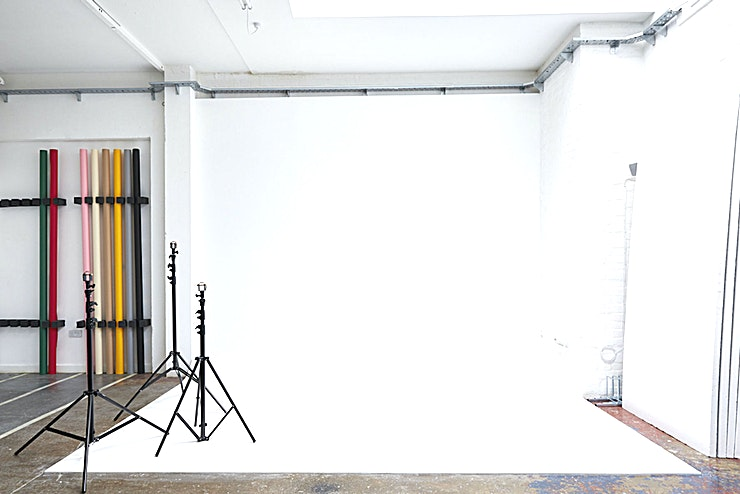 Creative Studio **Hire the creative studio space at CLASH Studios, for one of the best options for studio hire London has to offer!**   CLASH Studios is a new high-ceilinged 700 sq. foot photography, film and event space in Dalston benefitting from natural light. We offer a professional, affordable and reliable service to the photography industry, handling all aspects of hire from lighting, set design coordination and post-production.  The studio comes equipped with a full range of Colorama backgrounds, stands, boards, bags, and weights, and can be kitted out per request with bespoke photographic and film lighting. Audio is provided by a Bluesound system for a crystal-clear wireless solution to music and entertainment, and the space is supplied with its own high-speed wifi network.