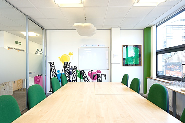 Mint Innit **Mint Innit is one of several rooms contained within The Waterfront Offices. Set beside the river on central Bristol's Welsh Back, this meeting room's central location is second to none.**  Mint Innit is a bright and funky space which is perfect for board room style meetings for up to 8 people. All rooms come with complementary hot drinks and water, with your catering requirements managed by a superb local caterer. When booking, just let us know if you would like catering and we will contact you to discuss in more detail. The costs of room hire also include access to Wifi, audio visual equipment, along with access to a large kitchen with free tea and coffee making facilities, ping pong table, eating area and sofas. Various other services such as printing and photocopying are also available.  **More details about the venue:**  The Waterfront meeting, conference and training rooms can be found on the 1st and 2nd floors of newly refurbished offices situated on Welsh Back in Central Bristol, with stunning views overlooking the floating harbour. A stones throw from Bristol's City Centre, Queens Square and less than a 10 minute walk from Bristol Temple Meads Train Station - making these the most ideally located meeting rooms Bristol has to offer!   The space is dedicated to hosting an array of conference, meeting and training events of varying sizes, from a Board Room of 6, up to a training or meeting/conference room for 50 in a theatre style.   The floor has a funky Bristol feel, with photos and murals of Bristol's famous sites including the iconic Clifton suspension bridge, SS Great Britain and the colourful houses of Totterdown. Others murals reflect the room names, all of which are Bristol colloquial phrases from Brizzle to Gert Lush.   Accompanying the meeting rooms is access to a large fully equipped break out space including kitchen, sofas, space to eat and also a table tennis table. All of this surrounded by exceptional views of Bristol and the river. 