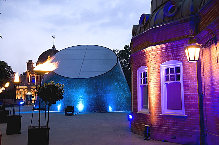 Peter Harrison Planetarium  **Want a showstopping venue to hire in London? Welcome to the Peter Harrison Planetarium at The Royal Observatory.**   The Peter Harrison Planetarium is a modern, versatile venue with contemporary lines and abundant lighted, located at the heart of Greenwich Park in the striking late-Victorian Astronomy Centre. The futuristic building, as well as the theme of astronomy exploration, makes this a perfect place for product launches and intimate celebrations.   The Peter Harrison Planetarium foyer boasts floor-to-ceiling windows and a star-studded floor where you can dine and entertain your guests. One of our talented astronomers is available to tailor a planetarium show; whether that you wish to transport guests to anywhere in the world, at any time, fly to the heart of the sun or simply enjoy the sky that evening.