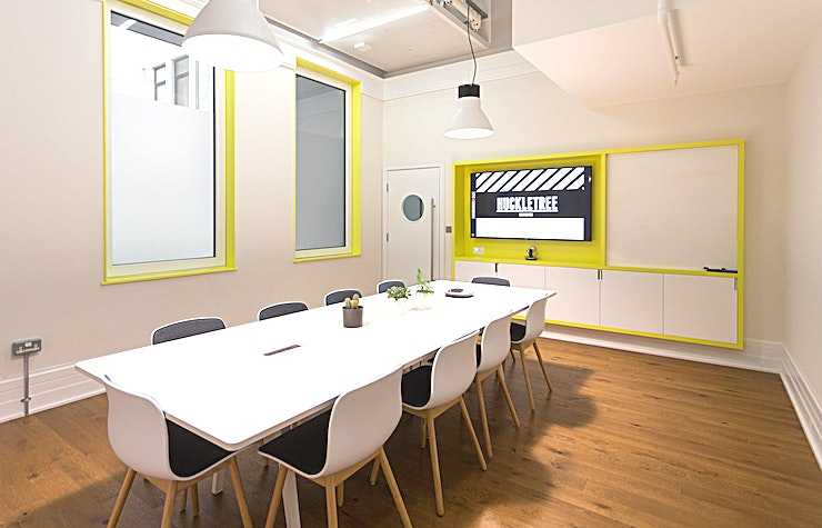 Menlo Meeting Room **Hire the Menlo Meeting Room at the Huckletree Shoreditch for one of the best options for creative meeting rooms hire London has to offer.**  A creative meeting room to hire in hip East London, Huckletree Shoreditch has plenty of style and cool-appeal. The venue has a super convenient location, situated half way between Moorgate and Old Street. It is the perfect setting for teams from offices in the City or from the creative tech hubs and start-ups around the Old Street roundabout. Huckletree Shoreditch sits within the iconic Alphabeta Building, which is known for its stunning revamp in recent years and which now epitomises the modern office space of the future. The style and setup is certainly one that will impress your team or clients. If you're looking for unique meeting venues in London, look no further.   The Menlo Meeting Room is a bright Space that can be used for a whole range of corporate and creative events. The Space is perfect if you're looking to inject some energy and creativity into your meeting or event. It is the ideal set up for an idea generating session, a brainstorm, a team catch-up, an away day or training day. Alternatively, it is also a great backdrop for meetings outside the office or client presentations. The Menlo Meeting Room can easily accommodate up to ten people.   In addition, there is also an internal urban garden space with a small kitchen area at the entrance of the meeting room. This extra space makes it ideal for longer half-day or full-day meetings in one of the best meeting rooms Shoreditch has to offer.  This London meeting room hire is somewhere creative and inspiring to motivate your team or impress external guests.