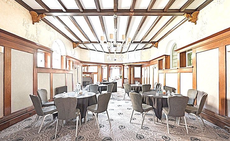 Oak **The Oak is a newly refurbished room located on the ground floor of the desirable Richmond Hill Hotel.**  The Oak benefits from original wood panelling and ornate ceiling features and is ideal for meetings and private functions. The Oak room is also fully licensed for civil ceremonies and has a max capacity of 72 for a theatre style reception.