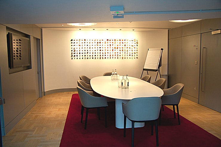 Terrace Boardroom **The Terrace Boardroom is an exclusive room boasting a stylish archaeological display.**   Perfect for intimate meetings, it also has a built-in plasma screen which can be linked to a laptop for pres
