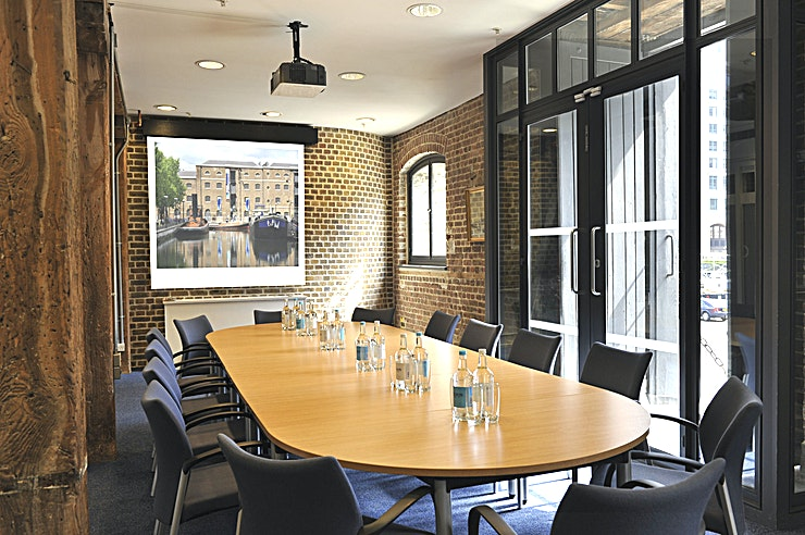 Docklands Boardroom **Hire the Docklands Boardroom at the Museum of London for your next private dinner staged in an iconic London venue!**  Located on the first floor with views out to the towering Canary Wharf skyline, this room is ideal for smaller meetings dinners for up to 16 people. Its peaceful location and abundant natural daylight make it a charming choice for more intimate events. The room can be hired for both daytime and evening events.  As part of Conference News' Meet Out to Help Out initiative, we're offering 20% off meeting room hire for events booked at the Museum of London in October 2020 – February 2021.
