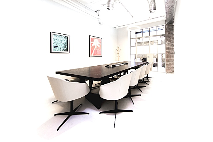 """Boardroom **The Boardroom at Fora Dallington Street is the ideal setting for important meetings for up to 12 people. Located within the Fora premium flexible workspace, minutes from Barbican and Old Street.**  Leading design fixtures and features and state-of-the-art technology enable your meetings to go global, without leaving the comfort of your space.  The Boardroom includes audio conferencing facilities with touch-screen controls, 65"""" Smart TV, wired and wireless connection to screen, USB rapid charging, super-fast Ethernet and Wi-Fi, AC and heating, Concierge service, and complimentary coffee and refreshments.  In addition, Room Service is available from our onsite restaurant Palatino at extra cost, with delicious Italian working lunches created by chef Stevie Parle.  Benefitting from high-quality service, our Boardroom is the perfect space for formal meetings, international business, high profile presentations and important interviews."""