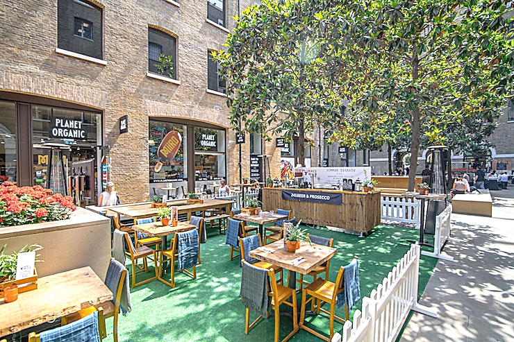 Outside Terrace  **Our covered terrace at Mac and Wild Devonshire Square is available for private hire.**   Located on Devonshire Square's Western Courtyard, outside the main entrance to Mac and Wild, the terrace is