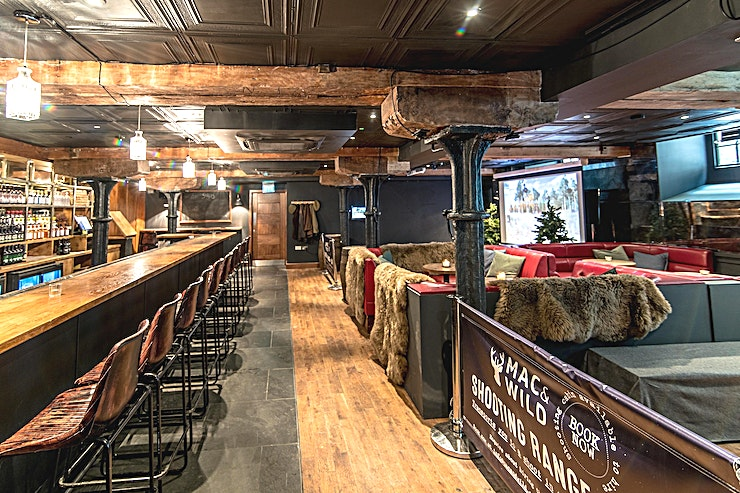 Shooting Range and Whiskey Bar  **Located on the lower ground floor of Mac & Wild Devonshire Square, the new Mac & Wild Shooting Range and Bar has two shooting lanes, each kitted out with our state-of-the-art virtual shooting system