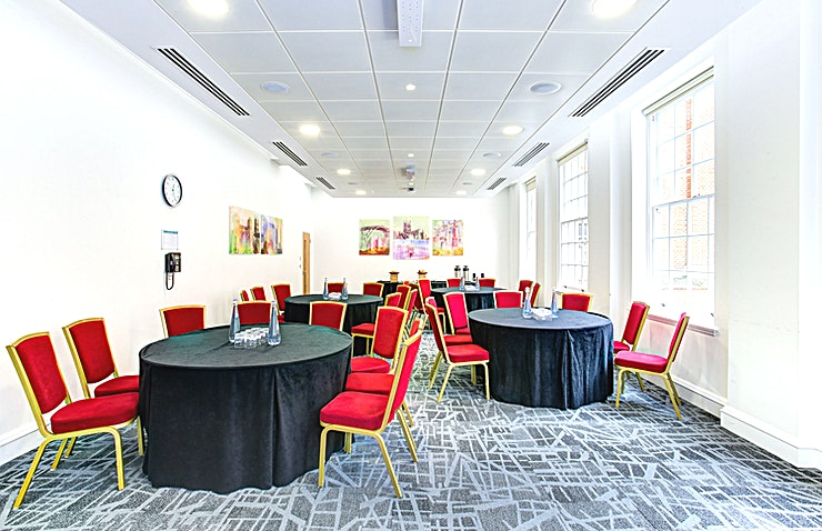 """Worcester Room **Hire the Worcester Room at the BMA House for one of the best options for meeting room hire London has to offer.**   The name of the room is connected to the origins of The British Medical Association, which was founded by Sir Charles Hastings, a doctor from Worcester in 1832. Hastings wanted a 'friendly and scientific' forum where doctors could advance and exchange medical knowledge.  The new space, accommodating up to 75 delegates, boasts plenty of natural daylight and views over the venue's magnificent Courtyard.  Delegates will enjoy first class AV facilities including video conferencing and use of four 55"""" LED screens, known as a video wall."""