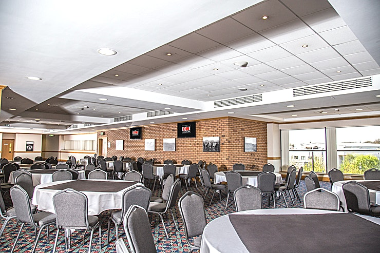 Springfield Lounge **Hire the Springfield Lounge at The DW Stadium for your next venue hire options in Wigan.**  Located in the heart of The Dave Whelan Stand on level two, this suite has the facility to be partitioned into three separate areas, making it ideal for events requiring workshop/breakout rooms plus private registrations, refreshment and reception space.  With an 8′ projection screen, ceiling mounted LCD projector and sound system, this lounge is perfect for theatre or cabaret style conferences or any type of event where presentation equipment and sound is required. Offering three bars, this Lounge is also the ideal choice for private lunches, dinners, buffet receptions and dinner dances