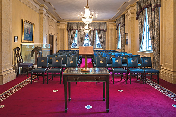 The Livery Room **The Livery Room at Saddlers' Hall is an elegant conference room for hire in St Paul's, London.**  With a series of elegant interconnecting rooms filled with warmth and natural light, Saddlers' Hall is a perfect place for various celebrations.  Amongst the remarkable features of the Great Hall is a charming musicians' gallery, an exquisite silver display case and captivating portraits of Past Masters of the Company. The Hall is accessed by a private courtyard with magnificent stone statuary and a water fountain.  Outside Courtyard can be used as a fair-weather reception space or for informal barbecues.  This price is based on an average day hire.