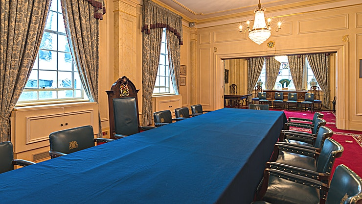 Court Room **The Court Room at Saddlers' Hall is an elegant functin room for hire in St Paul's, London.**  With a series of elegant interconnecting rooms filled with warmth and natural light, Saddlers' Hall is a perfect place for various celebrations.  Amongst the remarkable features of the Great Hall is a charming musicians' gallery, an exquisite silver display case and captivating portraits of Past Masters of the Company. The Hall is accessed by a private courtyard with magnificent stone statuary and a water fountain.  Outside Courtyard can be used as a fair-weather reception space or for informal barbecues.  This price is based on an average day hire.