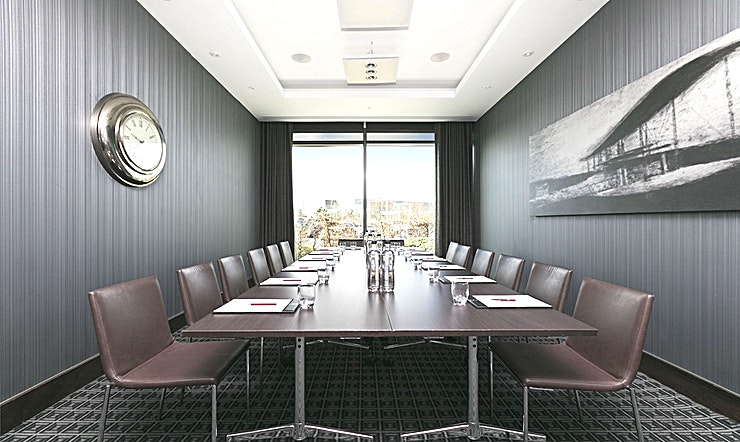 Boardroom **Hire the Boardroom at the Brooklands Hotel for your next venue to hire in Weybridge.**  The Boardroom benefits from floor to ceiling windows and has its own individually controlled air conditioning. The room has an inbuilt plasma screen which can be plugged into your laptop for presentations and we will include one flipchart for you.  Brooklands Hotel is full of contemporary architecture, iconic art deco-inspired interiors, award-winning dining, and all the mod cons you can imagine. The luxury 4 star Brooklands Hotel in Weybridge has to be seen to be believed.