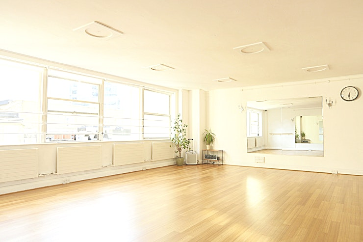 Studio 1 **Hire Studio 1 at London Rehearsal Space for your private rehearsal studio in London**  Hire Studio 1 at London Rehearsal Space for a vibrant studio right in the heart of the City. The space has wooden flooring, lots of natural light, long mirrors and ballet bars. Windows run all along the South side with a fantastic view of Ropemakers.   Studio 1 at London Rehearsal Space is the perfect venue hire for castings & auditions, dance rehearsals, music rehearsals, meetings, actors readings, yoga, photographic and film shoots and lots more!  Free wifi, yoga mats, chairs and tables and a top notch sound system are available.   The studio is within walking distance of Moorgate, Liverpool St, Barbican and Old Street tube stations so excellently located!