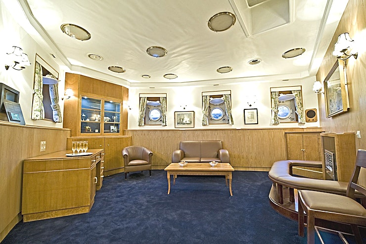 The Admiral's Quarters **Hire the historic Admiral Quarters at HMS Belfast, the perfect space for private dining or meetings rooms in London.**  Steeped in History, HMS Belfast London is an inspirational Royal Navy Warship and a memorable venue for private dining, meetings, product launches, wedding receptions, parties and more. Permanently moored between London Bridge and Tower Bridge, it's the most significant surviving Second World War Royal Navy warship, offering spectacular panoramic views of London and authentically decorated rooms - each with its own individual character. A welcoming atmosphere, first-class hospitality and dishes prepared on board by an expert team of chefs combine to make HMS Belfast a truly unforgettable experience for your guests.  Comprising the original Dining Room and Lounge area of the Admiral's own living quarters, the Admiral's Quarters are the perfect space for both boardroom meetings and elegant dining.  Restored to reflect how the space would have looked during the 1950's, the Admiral's Quarters provide a luxurious and intimate space for events.