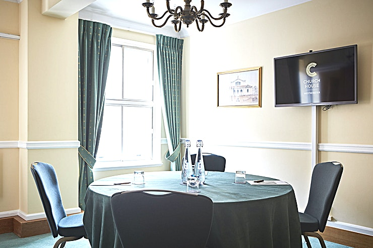 """College Room **Looking for an intimate London meeting room hire? Your search can end at the College Room at Church House, Westminster**  Located on the first floor, next to the Convocation Hall, the College Room is an intimate event Space ideal for your next small company event.  This Space is often used in conjunction with larger Spaces. Its intimate size makes it a suitable green room for speakers or an organiser's office. Creating a versatile meeting Space in the heart of Westminster.   It can also accommodate small meetings, presentations and interviews. An additional bonus to this Space is its interconnectivity with all other rooms.   The College Room also includes a 40"""" screen and complimentary WIFI. Providing everything the corporate client requires to host a successful meeting in London."""
