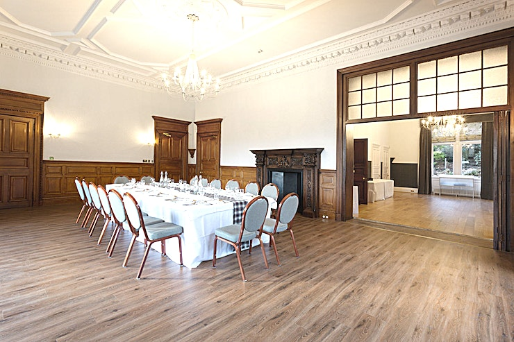 Gillespie **For an elegant meeting Space ideal for business events, the Gillespie room at Mansion House, Edinburgh Zoo couldn't be more perfect**  The rich oak panelling in this Space adds a touch of elegance to your next company event.  With a striking view across the park, you and your Guests will feel focused and fresh thanks to the abundance of natural light.  This Space also has access to Edinburgh Zoo's beautiful gardens. Enabling a post-conference Space for your team to discuss your meeting or admire the stunning surroundings.  Available for hire alongside the Geddes room, this versatile Space couldn't be more perfect for your next company event.