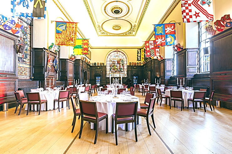 Exclusive use **Book Stationers' Hall and Garden for the ideal location for meeting and conference events**  Stationers' Hall has a  unique suite of inter-linking rooms and flexible layouts. Be it your Annual General Meeting, conference, away day or a product launch, for example, our experienced and enthusiastic team can help arrange that personalised and perfect event.  The Livery Hall is the largest of the function rooms. Gleaming oak flooring and carved oak panelling originating from the 1600s, together with huge stained glass windows give this room an impressive ambience.  The Court Room is a wonderfully bright room, richly carpeted and with rococo ornamentation in gold adorning the walls, it is dominated by an 18th century carved mantelpiece. It is very popular for smaller meetings, seminars, AGMs as well as civil wedding ceremonies.  The beautiful paved and landscaped Garden is a private and secluded space which all clients may make use of when hiring the Hall.   The oak panelling and carvings in the Stock Room date back to the 17th century while round the friezes are displayed the armorial shields of Past Masters or the Company including HRH The Duke of Windsor.  Perfect as a pre-dinner reception area, breakout space or dance floor for evening events, we also allow candlelight in this room.