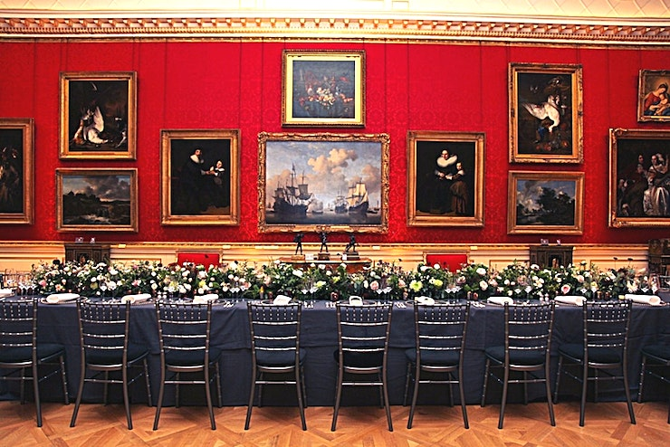 The Great Gallery **For an iconic London gallery Space, The Wallace Collection offers a wonderful option available for hire**  Hailed as 'the greatest picture gallery in Europe', the Great Gallery showcases some of the world's most celebrated Old Master paintings and houses the venue's most iconic pieces. Frans Hals' The Laughing Cavalier and works by Titian, Rubens and Velázquez all lay within these four magnificent walls.  The red decor enhances all of the iconic artwork, making this Space a spectacular Space for any occasion.  Host a superb drinks reception or networking event in this stunning Space. Indulge your Guests in incredible artwork and refined decor.   You couldn't ask for a more historic or iconic location to inspire conversation amongst your Guests and entertain your clients in an amazing venue.