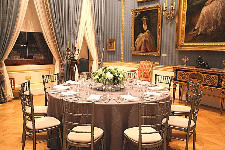 The West Room **For an iconic London gallery Space, The Wallace Collection offers a wonderful option available for hire**  This gallery houses paintings by the masters of eighteenth-century British portraiture, Gainsborough and Reynolds.   It provides a striking and unique setting for intimate dinners.  Featuring a beautiful chandelier and ornate portrait frames, this Space exudes sophistication and splendour.  Indulge your Guests in a striking location, ideal for making an impact on clients and colleagues.  The incredible ornaments in this Space make for great conversation starters among your Guests, perfect for an evening hire of entertaining.