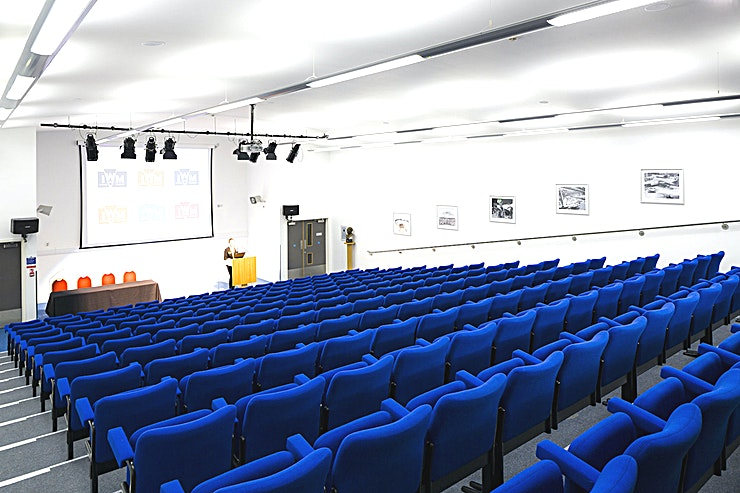 Marshall Auditorium **Need an expansive event Space for a large-scale corporate event? Look no further than the Marshall Auditorium at IWM Duxford**  This state-of-the-art, contemporary auditorium seats up to 200 Guests for a versatile event Space for an array of hire options.  Offering facilities for meetings, presentations, seminars and lectures, it boasts high quality audio sound, a built-in high specification PA system and adjustable lighting. Everything you need for your next event is here at IWM Duxford.  Key features of this auditorium hire include temperature control, fixed seating for maximum impact, easy to use hand-held control panel allowing quick and easy alterations to sound levels and lighting.  Wi-Fi access is also available, making this an ideal and efficient venue for corporate hire.