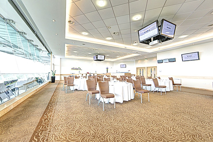 Downs View Room **The Downs Views Room at Epsom Downs Racecourse offers an astounding Space for your next corporate hire**  Host a meeting or conference in the Downs View Room for an airy and atmospheric setting.