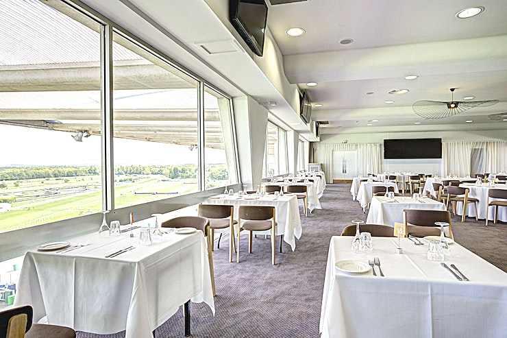 Equus Suite **Minimalist modern design create an event Space with a striking view**