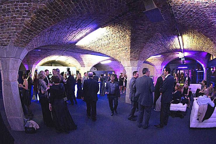 South Vaults **South Vaults at Tobacco Dock is a large, blank canvas event Space for hire in London.**  The Vaults at Tobacco Dock are made up of fourteen individual, multi-functional spaces. Ranging in capacity they can be used independently or in combination depending upon your requirements.  Barrel ceilinged with exposed brickwork they make an interesting and characterful backdrop to your event, as well as providing a blank canvas for branding and theming.  Benefitting from impressive lighting and audio-visual services as well as speedy, high capacity Wi-Fi connection, the Spaces can be adapted to accommodate a range of events including parties, meetings, exhibitions,  and exhibitions.