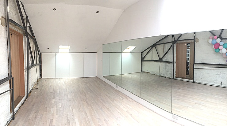 Dance and Photography Studio **The dance studio at Bustle is a beautiful light Dance and Photographic Studio to hire in Limehouse.**  The Space is light and airy with grey timber floors, a tall ceiling and full-height mirrors t