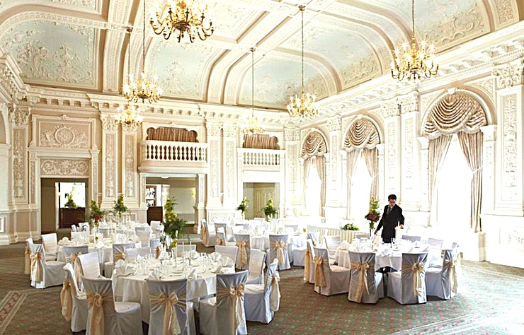 Compton Room **Conference ballroom to hire in The Grand Hotel, Eastbourne.**  The Compton Room is situated on the mezzanine level, an awe-inspiring room, adorned with ornate plaster work dating back to the Victorian era with spectacular stained glass windows.   A favourite for AV companies due to its extremely high ceiling and inbuilt stage.
