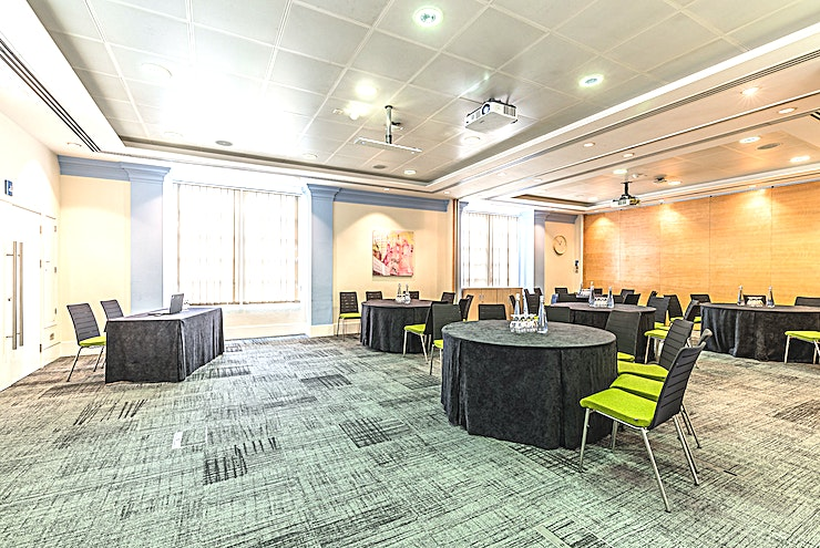 Murrell Barnes Suite **Hire the Murrell Barnes Suite for one of the best options for venue hire London has to offer for corporate events at the BMA House.**   Comprising the Murrell and Barnes Rooms, the Murrell Barnes Suite can accommodate up to 100 people.  This room offers that all important natural daylight and direct access to our lovely courtyard. This top London venue, the Murrell Barnes Suite, can seat up to 88 guests for a theatre-style event such as a conference or workshop. As well as being able to seat up to 38 guests for a boardroom style meeting.