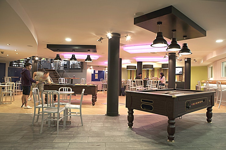 Games Room **If you are looking for a private party venue in Dublin, look no further than the Games Room at Generator Dublin.**   Within the trendy neighbourhood of Smithfield, adjacent to the Jameson Distillery and just a short walk from Temple Bar sits Generator Dublin.   The Games Room has capacity for up to 10 Guests making it the ideal room hire for private parties, meetings or private dinner.  The venue has an unruffled industrial feel thanks to its reclaimed wood, exposed brickwork and original stonework. With Irish music belting out of the nearby Temple Bar pubs, Generator Dublin is one of the most sought-after event Spaces the city has to offer.