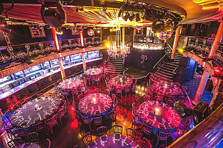 Whole Venue **Hire Café De Paris, a truly unique Soho restaurant, for your next private party venue hire in London**  Café de Paris first opened in London's West End in 1924. Ninety years on, and this now world-famous venue is still widely accepted as being the best cabaret venue in the city.   Playing host to the very best performers of circus, burlesque, music, magic, cabaret and jazz acts, Café de Paris always provides Guests with a night to remember.   A dazzling and opulent event space, Café de Paris never fails to leave a lasting impression as it is one of the best venue hires that west London has to offer.   With many original features, including the grand sweeping staircases, glittering chandeliers and stunning ballroom floor, Cafe de Paris makes for the perfect space to host a corporate event in central London.  Café De Paris is the private venue hire that has it all. A sparkling central location, breakout Spaces, WiFi, filming facilities, onsite technical support and an early access option, this venue hire supplies everything your events need.  Wonderfully flexible, the seating plans can be arranged for anywhere between 120 and 715 Guests. A variety of food and drink options are available, underpinned with a late alcohol license, making Café De Paris ideally suited for private parties, dining and receptions.   This sensational Space is also a one of a kind venue for conferencing, away days, meetings and product launches.   A brilliant backdrop to captivate your corporate clients.