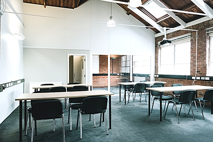 The Loft **The Loft is a unique venue that caters for groups of up to 50 people and is ideal for private meetings and away days.**  Based in the heart of Winchester, access is easy with a car park a 5-minute walk away and direct trains to London via Winchester train station which is just a 10-minute walk.   The Loft features exposed period brickwork and wooden ceiling beams. It is split into a large main area with projector and white-board and a separate breakout room.   The venue is self-contained and has access to a private kitchen and toilet. Tea and coffee making facilities are provided and catering can be arranged in advance with our local catering partners.