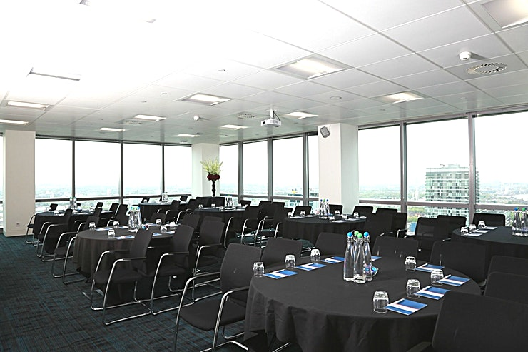Elite 1 **Elite 1 at CCT Venues Plus-Bank Street is a large events venue available to hire in Canary Wharf.**  Just a minute's walk from Canary Wharf tube station, this stunning venue at 40 Bank Street offers events space that makes an impact for all the right reasons.   On the upper floors of this pristine 32-storey office complex, we have 26 flexible meeting rooms with floor-to-ceiling windows that boast breath-taking views across London.