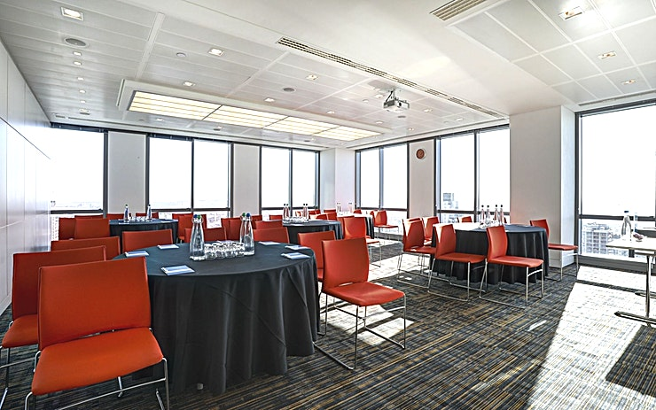 Room 5 **Room 5 at CCT Venues Plus-Bank Street is a versatile, modern events venue available to hire in Canary Wharf.**  Just a minute's walk from Canary Wharf tube station, this stunning venue at 40 Bank Street offers events space that makes an impact for all the right reasons.   On the upper floors of this pristine 32-storey office complex, we have 26 flexible meeting rooms with floor-to-ceiling windows that boast breath-taking views across London.