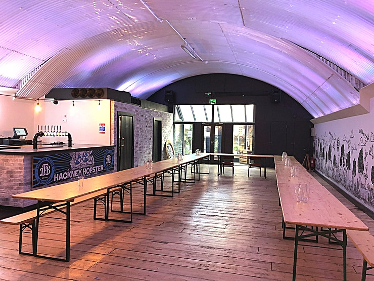 Light Arch Hire the Light Arch at The Brewhouse for your next blank canvas venue hire in Hackney. This spacious venue is ideal for conferences, workshops or private party venue hire.   The Brewhouse is a fantastic new venue to hire set in the heart of Hackney East London. It operates out of two large railway arches, with an outdoor courtyard joining the two areas. It is both spacious and versatile, retaining all the natural charm of the original build and allowing you to adapt the space for your needs.  This unique venue hire in Hackney has rapidly becoming one of East London's most sought after venues for those promoters, events organisers, newly weds or birthday revellers looking to host their event in a truly memorable environment. We are able to cater to most needs with an impressive portfolio of past events which has seen us expand our facilities to include a fully operational stage perfect for 'live' bands or performances.   ***PRICE IS INDICATIVE OF DRY HIRE***