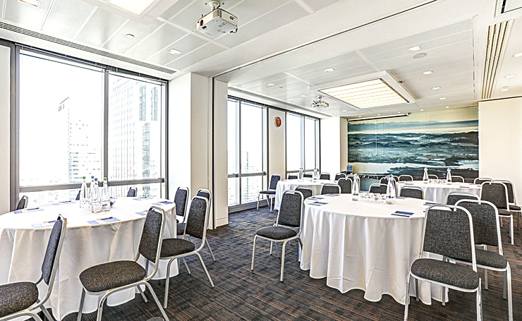 Room 14 **Room 14 at CCT Venues Plus-Bank Street is a flexible events venue available to hire in Canary Wharf.**  Just a minute's walk from Canary Wharf tube station, this stunning venue at 40 Bank Street offers events space that makes an impact for all the right reasons.   On the upper floors of this pristine 32-storey office complex, we have 26 flexible rooms with floor-to-ceiling windows that boast breath-taking views across London.