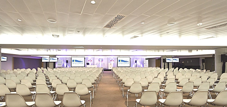 Presidents Area **The Presidents Area is a large events Space for hire in Dublin, located in the iconic Aviva Stadium.**  The Presidents Area is our principle largest single event space within Aviva Stadium. It is located on Level Two on the west side of the Stadium and is over 1650 square meters.   The Space is very versatile and can be used for both conferencing for up to 1000 people and dining for up to 1200 people.   The Presidents Area also contains a dividing wall which separates the space into the Presidents Suite and the Presidents Terrace which has natural daylight and an outdoor area.   The outdoor area can be found to the north of the space which will facilitate guests getting some fresh air during the event.   This is a fully contained event space complete with direct access lifts, private staircase, lobby area and cloakroom area.  A distinctive feature of the space is the light boxes along the wall which can reflect our client's brand colours.   Plasma Screens around the room can be utilized by organizers for brand awareness and relay screens for presentations or speeches.  The Space is often used in conjunction with the Atrium on Level 3 and the large outdoor area of the Podium.