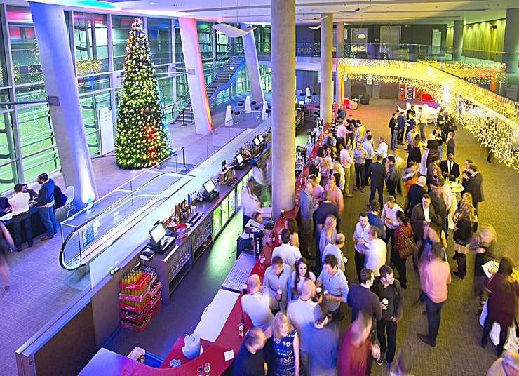 1872 **1872 is a spectacular Dublin events Space to hire, perfect for awards dinners, corporate events and conferences.**  This spectacular double height space has marvellous views of the iconic pitch and expansive views of Dublin City.   1872 is the year in which Henry Dunlop opened the Stadium for athletics on Lansdowne Road. This spectacular double height space has marvellous views of the iconic pitch and expansive views of Dublin City.   1872 is located on Level 3, which is the Premium Level on a match day. It is a bright, airy space, flooded with natural daylight. Two sweeping staircases dominate the Space and lead up to a mezzanine area.  The Space has full AV specifications, 3 Phase Power, Complimentary Wi-Fi, hanging eyes which allows banner, fixture hangings etc. 1872 is versatile space and ideal for dinners, networking receptions, conferences, and award ceremonies – a unique Space in a unique venue.