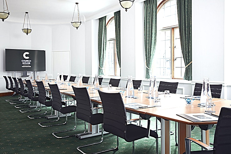 Council Room **For a London meeting Space with a classically refined touch, the Council Room at Church House, Westminster is a premium choice**  Located on the ground floor, the Council Room offers a wonderful view of Dean's Yard and Westminster Abbey.   With its small lobby, this elegant room can be used as a self-contained area. This makes the Space ideal for private functions. Particularly suiting small meetings and private dinners.  With crisp, sophisticated furnishings, this Space is sure to make Guests feel focused.   At just a short walk from Westminster tube station, this London meeting room hire is perfectly suited to the corporate client.